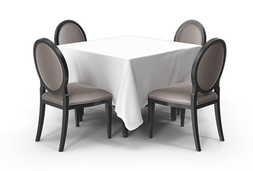 שולחן עם מפה וכיסאות בצד